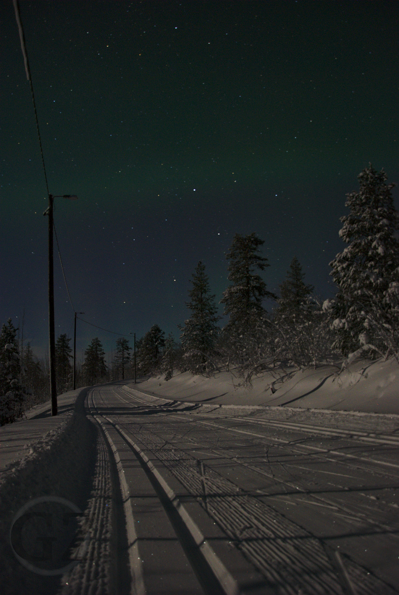 cross country skiing tracks in the moon light