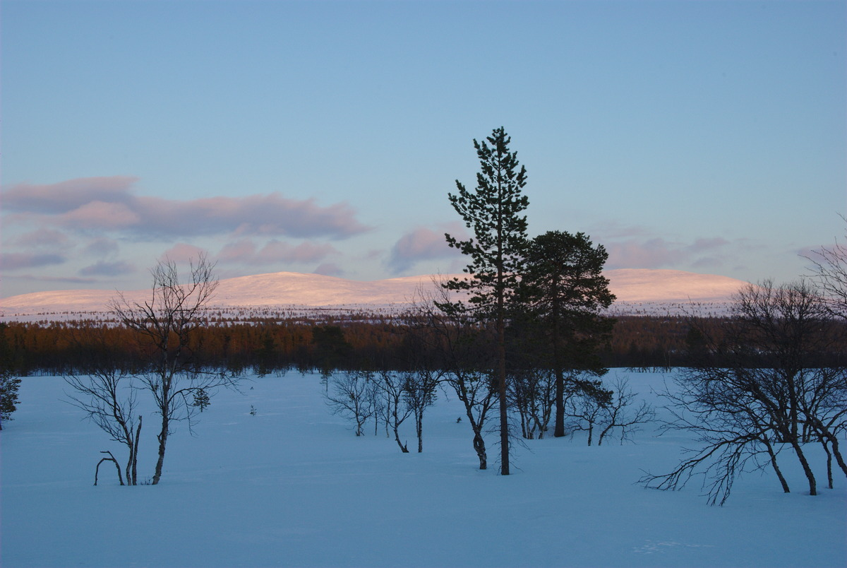 View from the skiing trail toward the mountains in the sun set