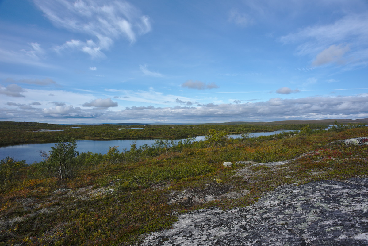 view from a fjell down to long and narrow lake