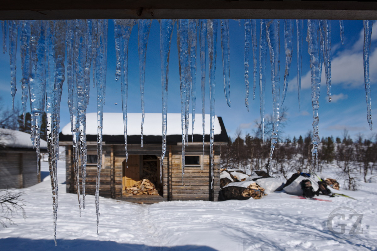 Icicles hanging from roof of Hannukuru sauna building