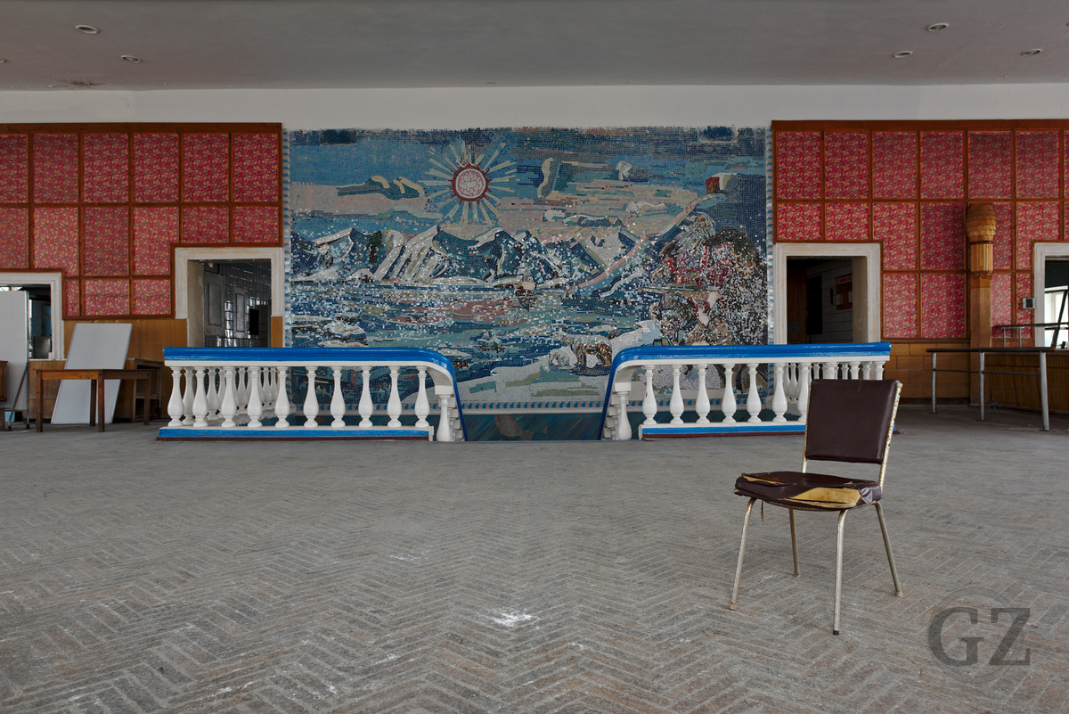 Empty canteen with huge wall mosaic