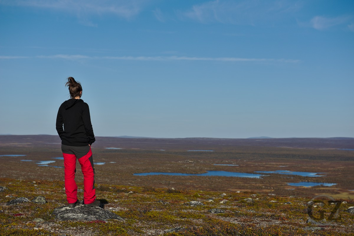 Person on fell, looking back at open tundra area