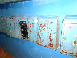 rusty mail boxes in apartment house